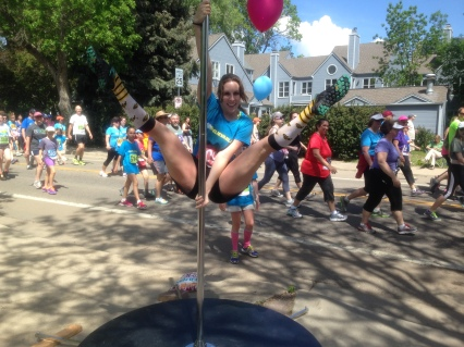 Kristen is a ringer. She's running the race but she's pole dancer, too.